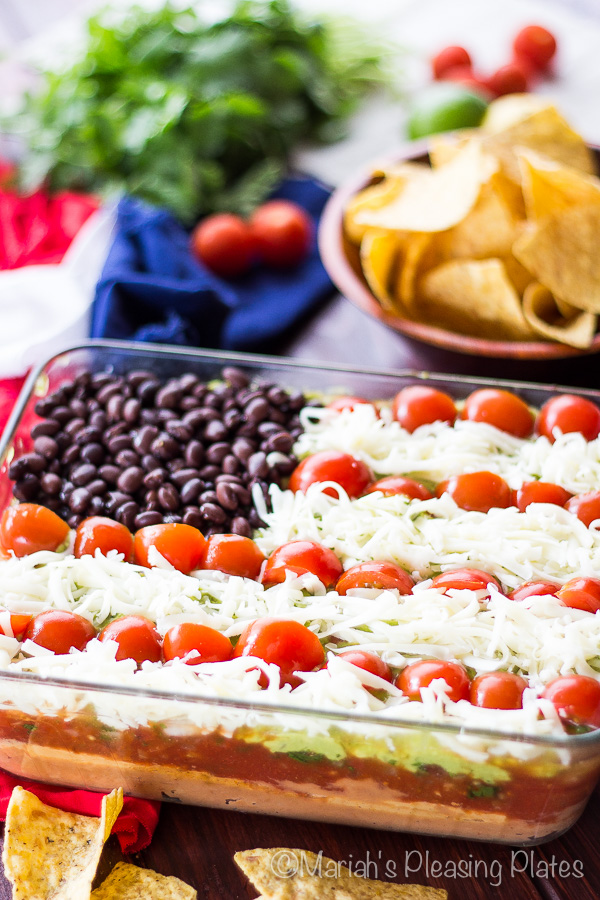 Lightened Up 7 Layer Dip. Are you looking for some ideas for your 4th of July food recipes? I made my list of the best Patriotic recipes for the Independence day party. Enjoy these 4th of July food ideas and save your favorite to your 4th of July Food board on Pinterest to check the recipe later! #4thofjuly