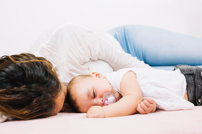 Find out why is it not safe for babies to sleep on their stomach, is it OK for baby to sleep on tummy and how you can teach your baby to sleep on her back.